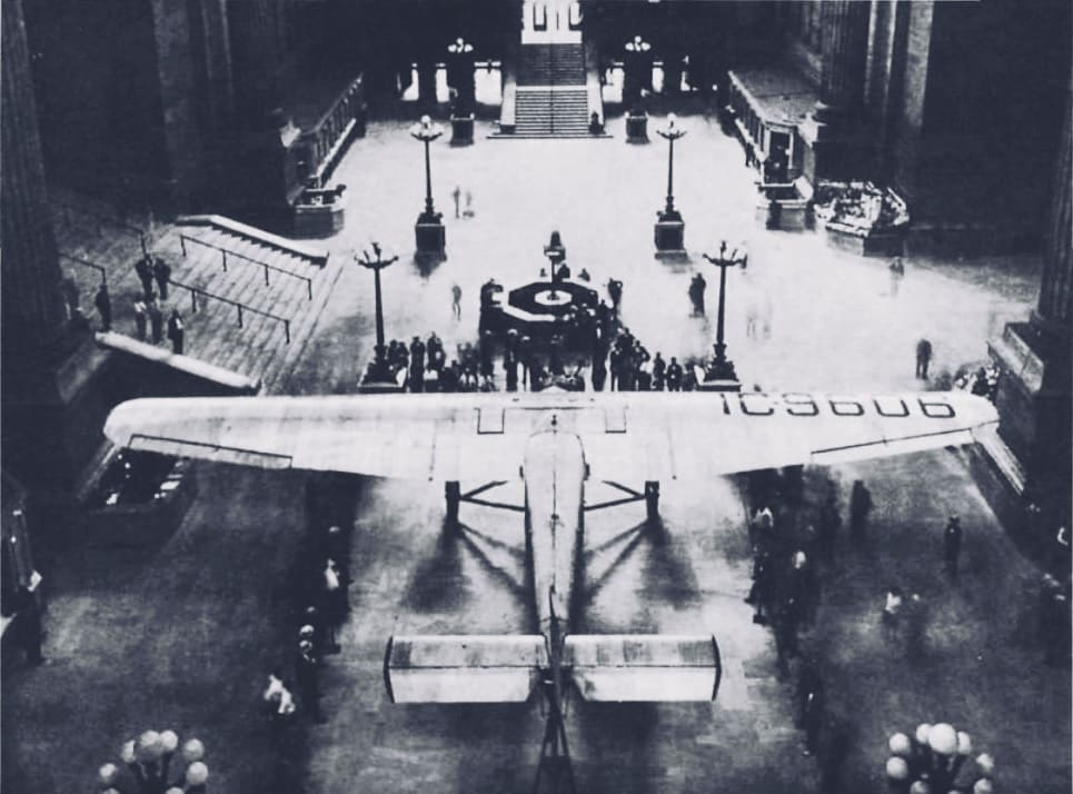"Ford Tri-Motor ""City of New York"" at hall NYC Pennsylvania station, - US History of Tourism - TAT - Lindbergh Line - First Coast to Coast Flight"